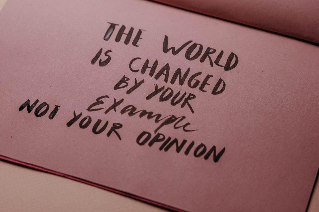 How to be more sustainable | Text: 'The wold is changed by your example, not your opinion'