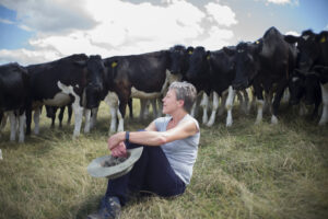 Helen Browning in field with cows
